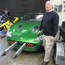 ECE alumnus Michael VanBlaricum brought three vehicles used in James Bond films for display at Engineering Open House. He is standing by a car used in the film <i>Die Another Day.</i>