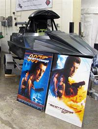 The Q boat was displayed with two posters for <i>The World Is Not Enough,</i> the film in which it was featured.