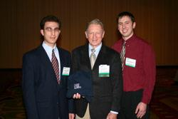 Principal Systems Engineer Chuck Mullett of ON Semiconductor, an ECE alumnus, presented the Illinois team with a $2,000 prize at the IEEE Applied Power Electronics Conference in Austin, TX, in March 2005. ECE graduate students Joseph Mossoba (left) and Nicholas Benavides (right) are pictured with Mullett.