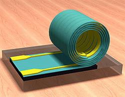 ECE Associate Professor Xiuling Li led a team of Illinois researchers who developed a new design paradigm for inductors. Processed while flat, the inductors then roll up on their own, taking up much less space on a chip. Image by Xiuling Li.