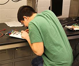 An Illinois student participant working diligently during one of the ECE Pulse 2013 competitions.