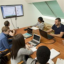 Engineering students collaborate using a private group study room, equipped with a 55' flat screen monitor with a laptop connection.