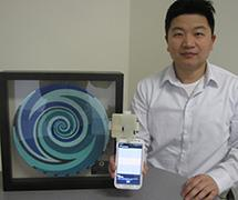 Assistant Professor Liu with the MoboSens sensor and Vodafone award. Liu and the MoboSens team were recognized at the Vodafone Wireless Innovation Project awards ceremony and Global Philanthropy Forum at Silicon Valley on April 16.