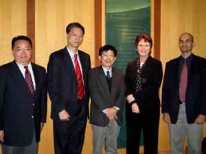 ITRI visitors Sin-Yuan (Stephen) Cho, An-Yu (Andy) Wu, and Sheng-Fu Horng with ECE's Beth Katsinas and Naresh Shanbhag (left to right).