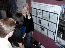 ECE postdoc Amy Oldenburg (right), discusses her research with Nanotechnology Industry Workshop attendees. Oldenburg works in ECE professor Stephen Boppart's Biophotonics Imaging Laboratory in the UI Beckman Institute.