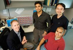 ECE Professor Brian Cunningham and graduate students, from left, Nikhil Ganesh, Wei Zhang and Patrick Mathias have set a new record for brightness of quantum dots. Photo by L. Brian Stauffer.