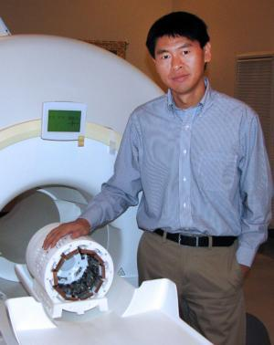 Ling Jian Meng with his hybrid nuclear imaging device.