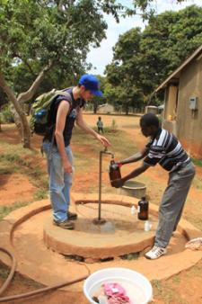 During a class trip to Kenya, CEE students draw water samples for testing from a local well.