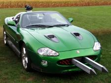 This custom-built Jaguar XKR was used in the car battle scene on ice vs. 007's Aston Martin DBS. The XKR was retro-fitted with several automatic panels for use by the special effects department to simulate artillery fire. An automatic Gatling gun is mounted on the back end.
