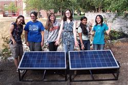 SWE Team Tech members test their solar system outside of Everitt Lab.
