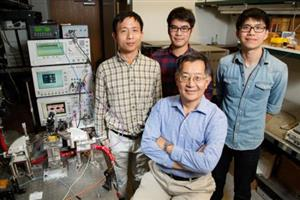 (from left) Postdoctoral researcher Fei Tan, graduate students Mong-Kai Wu and Michael Liu, led by Milton Feng (front)<br><em>Photo by L. Brian Stauffer</em>