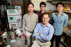 The team, from left: postdoctoral researcher Fei Tan, graduate students Mong-Kai Wu  and Michael Liu, led by Milton Feng, front. Photo by L. Brian Stauffer.