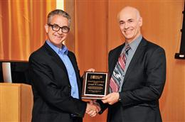 Professor Joseph Lyding, at right, accepting award from NBIC Director A. T. Charlie Johnson. Image courtesy of Felice Macera, University of Pennsylvania.