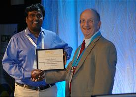 ECE PhD candidate Avinash Kumar (left) being presented the  IAPR Piero Zamperoni Best Student Paper Award at the International Conference on Pattern Recognition (ICPR) conference.