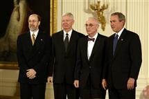 From left: Russ Dupuis, George Craford, and Nick Holonyak Jr. are pictured with then-President George W. Bush when they accepted the U.S. National Medal of Technology for their work on the light-emitting diode.