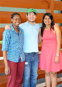 Chuma Kabaghe (left), Nikita Parikh (right) and their Senior Design partner Bauyrzhan Yermagambetov (middle) created the initial Anansi band for class.