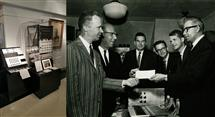 The old and new instruments housed at the Sousa Archives (left), and Beauchamp and other professors accepting a sponsorship check from a MagnaVox executive (right)