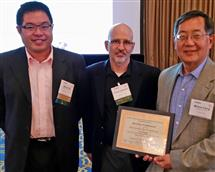 ECE Professor Milton Feng (right) and coauthor Barry Wu (left), who works at Keysight Technologies (formerly Agilent), receive the 2014 CSICS Best Student Paper award for colleague Huiming Xu from CSICS symposium chair Chuck Campbell.