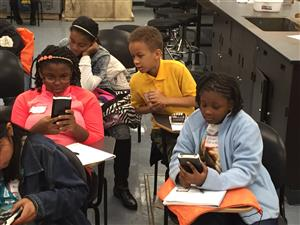 Students used a graphing calculator for the first time at the Oct. 24 workshop.