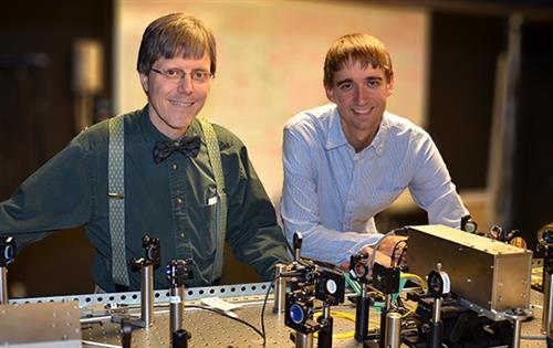 Professor of Physics Paul Kwiat and graduate student Brad Christensen in the lab