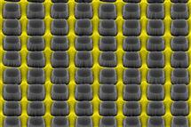 An array of nanopillars etched by thin layer of grate-patterned metal creates a nonreflective yet conductive surface that could improve electronic device performance.