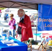 Professor Tony Leggett representing the Science at the Market booth