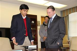 Touch Light founder Swarnav Pujari demonstrates his concept to Rob Astorino, Executive for Westchester County, New York. Astorino awarded Pujari the 2015 Earth Day Award.