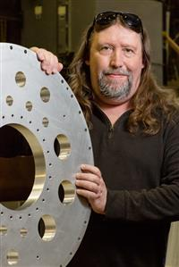 John Blackburn, a physical-science technical assistant in the experimental nuclear physics group at Physics Illinois, was awarded a Chancellor's Distinguished Staff Award.
