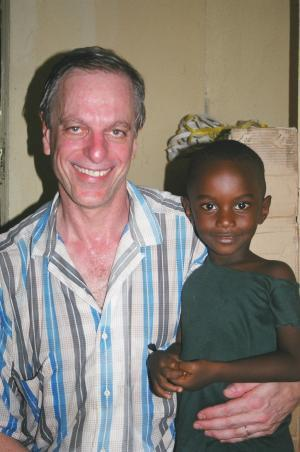 With a patient in Monrovia, Liberia (2003).