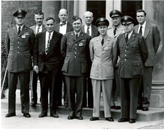 Armed Services representatives on a visit to the CSL in the 1950s. Back row, second from left, is Frederick Seitz, CSL director, standing next to F. Wheeler Loomis, Physics head. At the far right of the back row is Chalmers Sherwin, professor of physics. The photo was taken at the east entrance to the Laboratory of Physics, corner of Green and Mathews Streets.