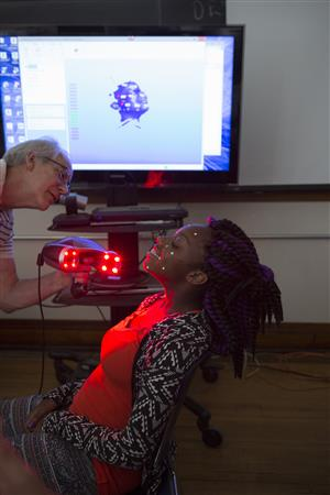 Ariana Hopkins holds still for a (painless) scanning of her face into a 3D digital model, which can then be printed in a 3D printer.