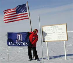 As part of his research work, Gardner visited the South Pole, where he happily unfurled an Illinois flag.