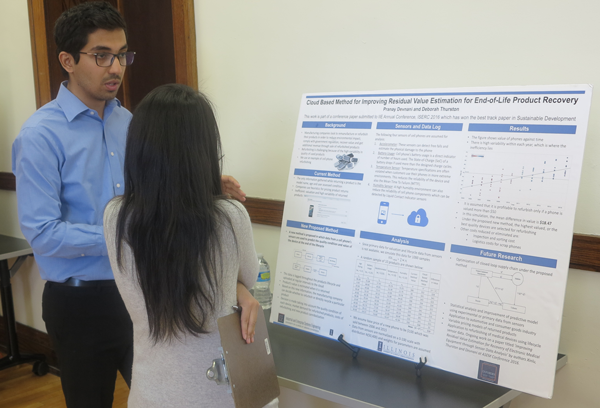 Pranay Devnani presenting his research at the Graduate Poster Symposium.