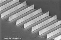 An array fin transistors made by the MacEtch method. The fins are tall and thin, with a higher aspect ratio and smoother sides than other methods can produce. Image by Yi Song