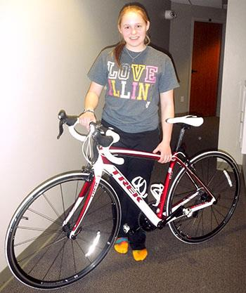 "Bioengineering sophomore Grace Deetjen shows off her new bike, which she says she nicknamed "" 'Phoenix' for the healing that it brings and for its lightness."""