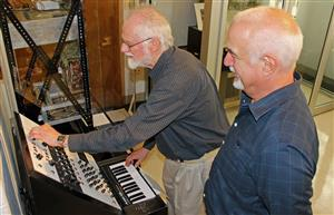 Emeritus Professor Jim Beauchamp (left) demonstrates Mark Smart's simulation of his Harmonic Tone Generator for Andy Hildebrand in the University Library's Sousa Archives.