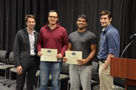 The Area Award for Interdisciplinary Work was awarded to Team 16 for 'The Design of an Intelligent Pump.' Team members: Connor Blair, Paul Cladek, and Vivek Koganti. Also pictured: John Capozzo (TA) and Professor Makela.