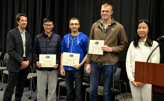 The Area Award for Transportation was awarded to Team 24 for 'A Smarter Bicycle Rack.' Team members: Brandon Hovick, Minsu Yu, and Nicholas Devito. Also pictured: Kexin Hui (TA) and Professor Makela.