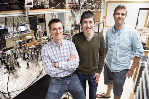 Assistant Professor of Physics Bryce Gadway poses with graduate students Eric Meier (left) and Fangzhao Alex An (center) in his lab, in Loomis Laboratory of Physics, University of Illinois at Urbana-Champaign. Photo credit: L. Brian Stauffer, University of Illinois at Urbana-Champaign