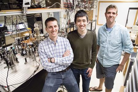 (l to r) Graduate students Eric Meier and Fangzhao Alex An with Bryce Gadway in Loomis Laboratory.