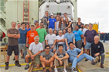 Members of the multi-institutional OASIS Expedition, led by the University of Illinois, pose for a photo. (Photo courtesy of P. Gregg [Illinois], D. Fornari [WHOI], and M. Perfit [University of Florida], co-chief scientists of OASIS cruise AT37-05 on R/V Atlantis funded by the National Science Foundation.)