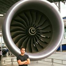 Josh in front of the Rolls-Royce engine of the third Dreamliner ever built at the Museum of Flight in Seattle during his Boeing internship.