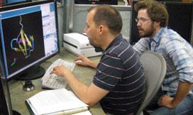 CPLC graduate student, Keith Cassidy (right), teaching VMD to 2011 Summer School student, Christoph Engl.