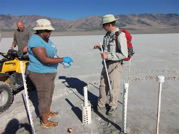 Lynch and her colleagues sampling hypersaline groundwater in the Pillot Valley Basin. Photo by Robin Schneider.