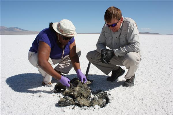 Lynch and her collaborator, Kevin Rey from Brigham Young University, examining sediments and overlying microbial mats. Photo by NASA Astrobiology Institute.