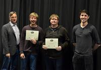 The Area Award for Courage is presented to David Rubrecth and Logan Marlow for their 'Device for Depositing Charged Metal Particles.' Also pictured: Professor Hutchinson, Sam Sagan (TA).