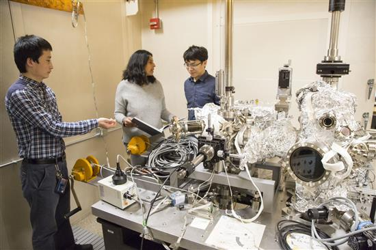 Vidya Madhavan, a professor of physics at the University of Illinois at Urbana-Champaign, works with students in her lab, in the Frederick Seitz Materials Research Lab. Madhavan specializes in condensed matter experimentation. Photo by L. Brian Stauffer, University of Illinois at Urbana-Champaign