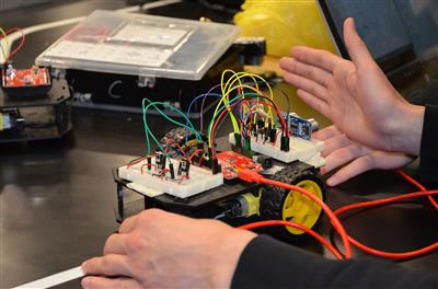 A student demonstrates a project in the Texas Instruments Electronics Design Lab.