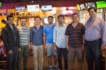 Sam Spencer was joined by members from his lab at the viewing party, including his advisor, Professor R. Srikant (second from right).