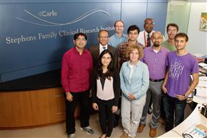 Researchers and physicians from the U. of I. and Carle Foundation Hospital developed a rapid test to find sepsis markers in a single drop of blood. Pictured, front row, from left: Astha Tanna and Dr. Karen White. Second row: Umer Hassan, Rashid Bashir, Tanmay Ghonge, Dr. Bobby Reddy Jr. and Ishan Taneja. Third row: Dr. Tor Jenson, Dr. James Kumar and Jacob Berger.